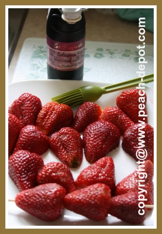 Coating Strawberries with Balsamic Vinegar for grilling