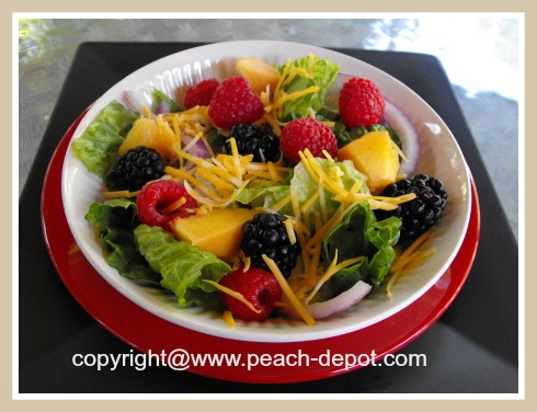 Leafy Green Salad with Fruit Peaches Berres and Greens